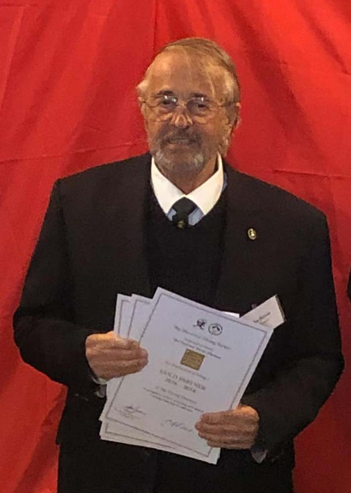 Chairman of the Historical Diving Society, dR John Bevan holding certificates he is about to present to our supporters.